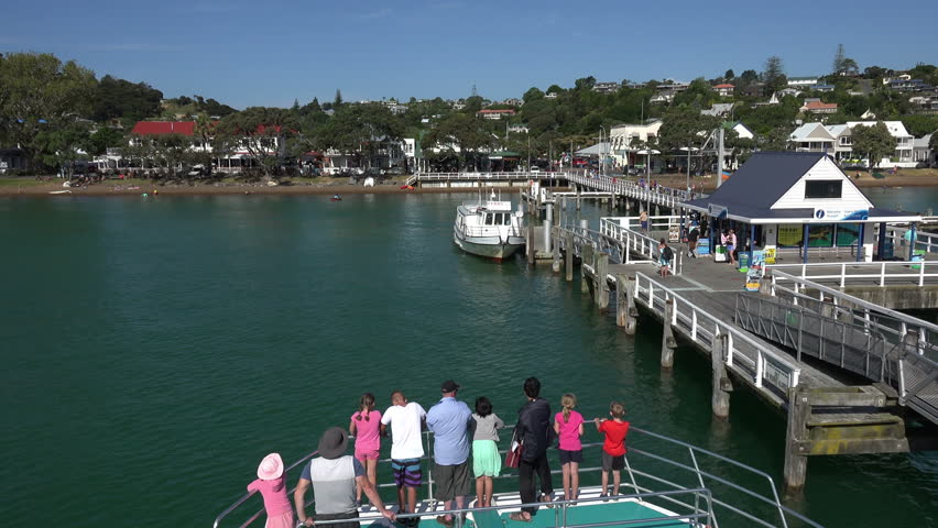 RUSSELL, NORTHLAND/NEW ZEALAND - JANUARY 16, 2015: Unidentified tourists  arrive at Russell by boat in Bay of Islands. It is one of the most popular tourist destinations in the country. - 4K stock footage clip