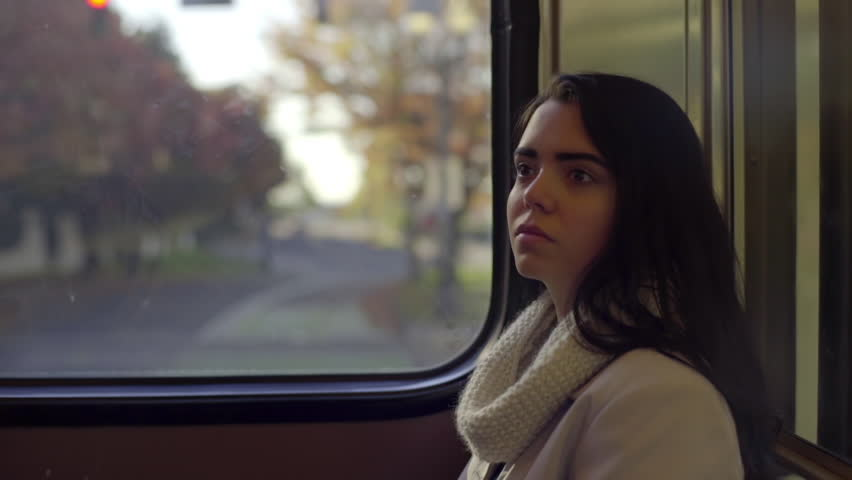 Mixed Race Young Woman Rides The Train Through City Park, Enjoys The Scenery