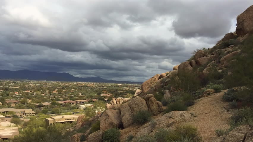 High viewpoint timelapse video footage of Scottsdale,Arizona - featuring moving viewpoint of beautiful boulder mountain boulder landscape with clouds floating across.