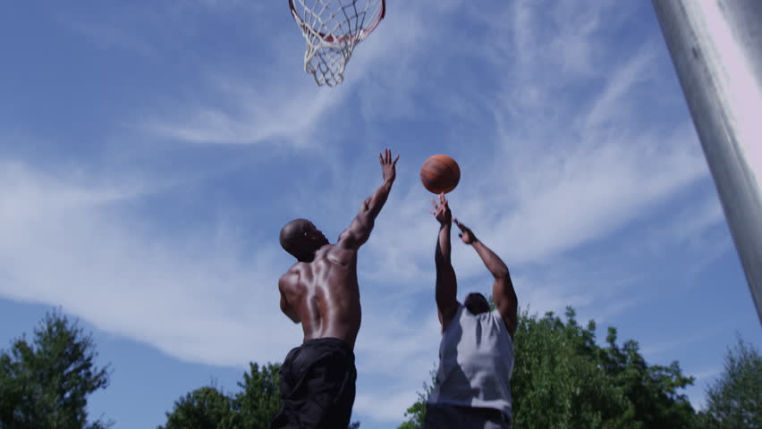 One on one street basketball; player shoots basket - 4K stock video clip