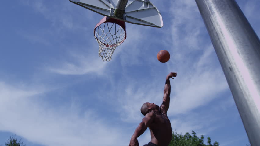 One on one street basketball; player is blocked - 4K stock video clip