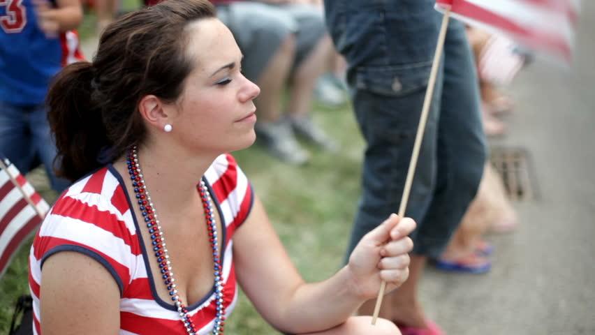 Girl Waving Flag at July 4th Parade - HD stock video clip