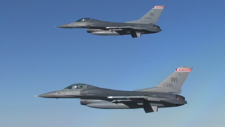 CIRCA 2010s - Two F-16 fighter jets fly in formation.