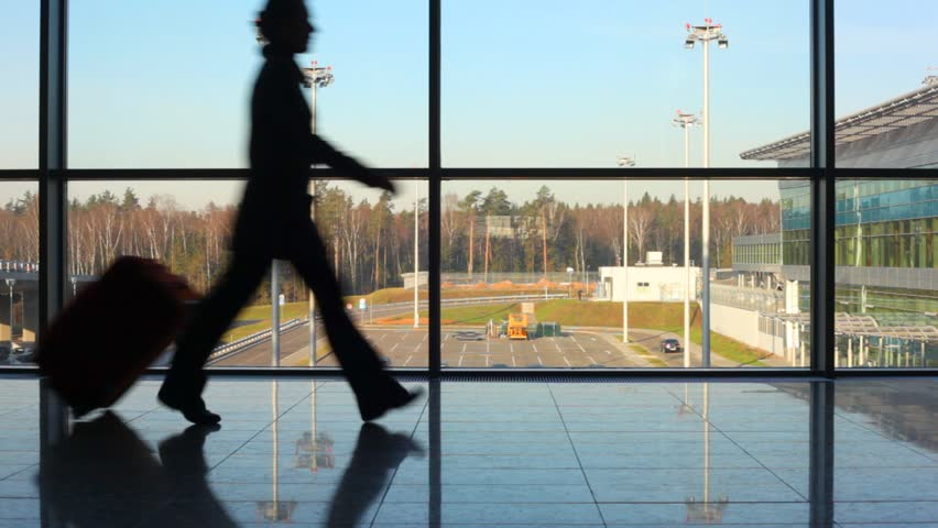 silhouettes of family hurry to aircraft against window at airport - HD stock video clip