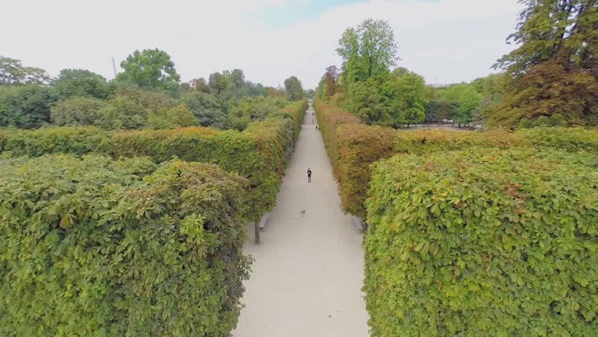 PARIS - SEP 11, 2014: Alley with people in Garden of Tuileries at autumn sunny day. Aerial view
