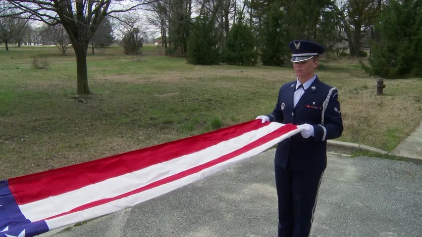 CIRCA 2010s - Soldiers from an honor guard perform a flag folding ceremony. - HD stock footage clip