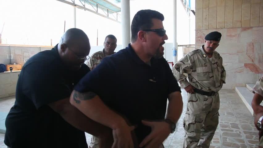 CIRCA 2010s - U.S. soldiers train the Iraqi Army in basic tactics.