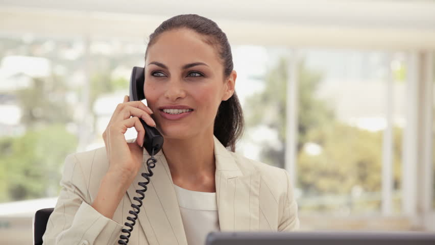 Businesswoman Using a Phone at the Office - HD stock video clip