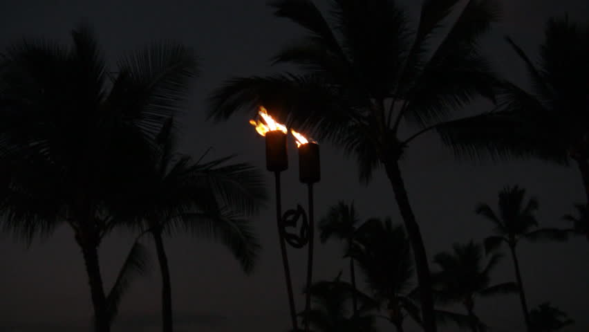 HD torches at night with lightening at Maui - HD stock footage clip