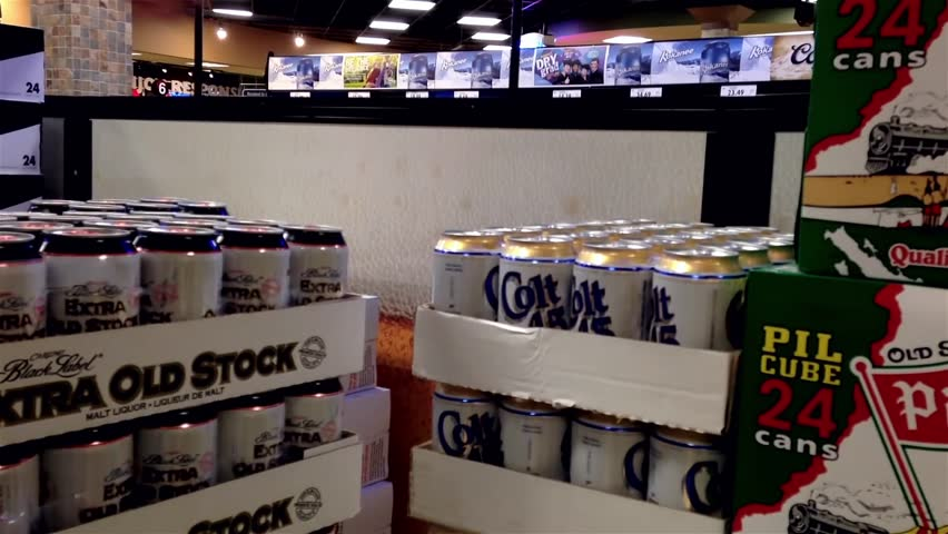 Coquitlam, BC, Canada - March 12, 2015 : Shoppers buying beer inside BC liquor store