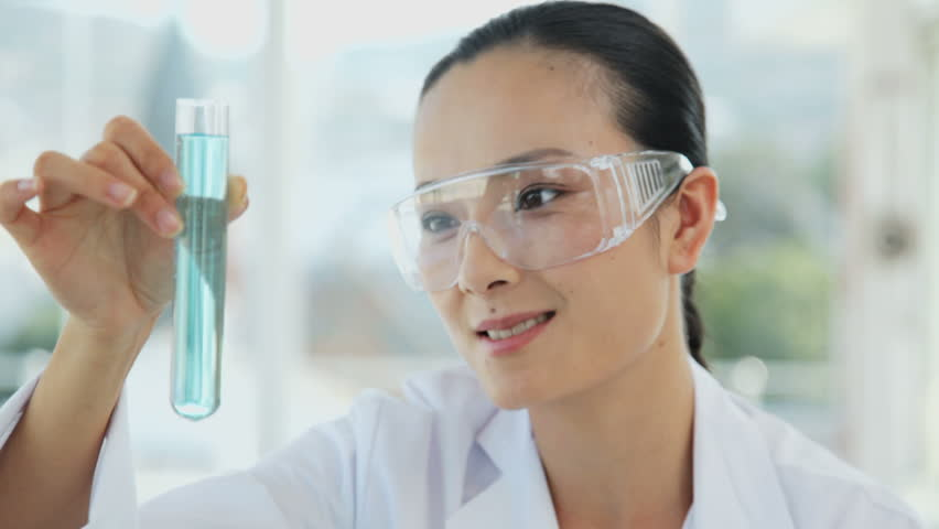Female Researcher Holding a Test Tube - HD stock video clip