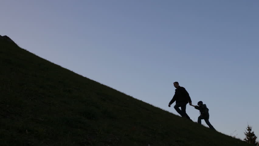father and son climbing uphill, metaphor