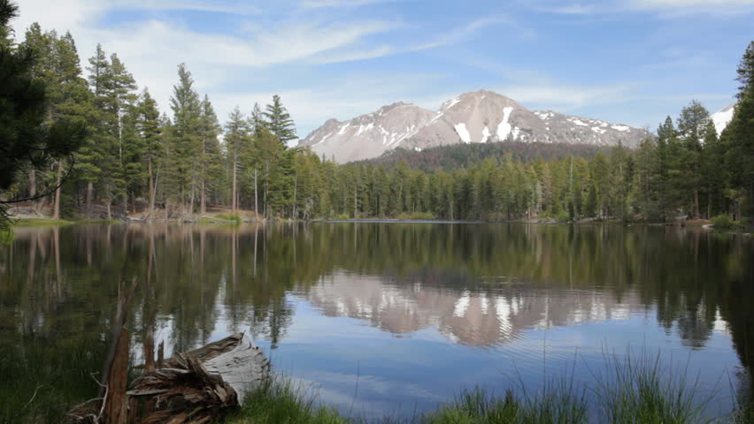 Late afternoon view of Chaos Crags reflecting in Reflection Lake in Lassen Volcanic National Park. - HD stock footage clip