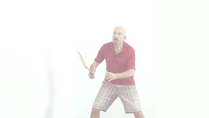 a bald man in a red shirt gets ready to play badminton,tennis,energetically Bouncing and waving his arms and communicates with facial expressions on the face. fade to white