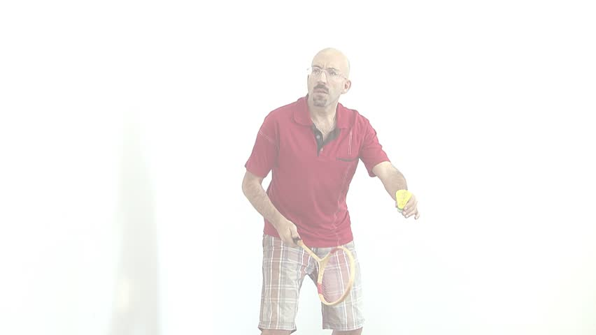 a bald man in a red shirt gets ready to play badminton,tennis,energetically Bouncing and waving his arms and communicates with facial expressions on the face. fade out to white