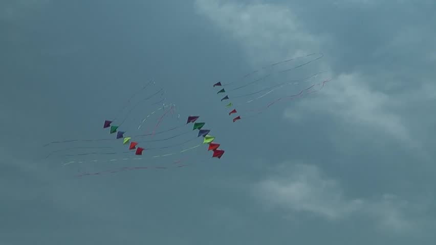 Three kites flying over a  sky. Summer Kite Festival - HD stock footage clip
