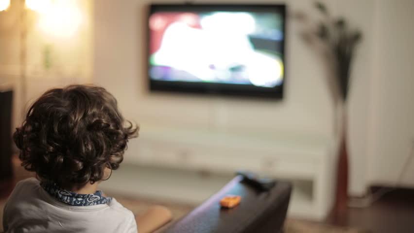 Child watching TV - dolly shot
