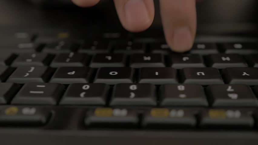 Woman typing on black keyboard in slow motion while dolly with camera passing by 1080p FullHD footage - Female fingers typing on keyboard in slow-mo 1920X1080 HD video