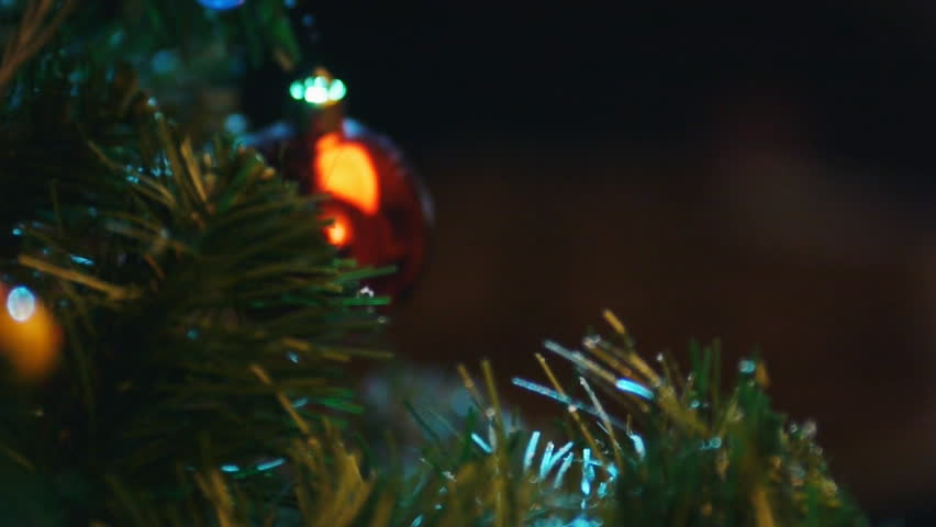 Christmas tree, lighting candles, cookies,  rack focus  - HD stock video clip