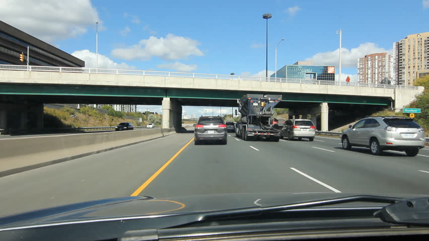 TORONTO, CANADA on OCT 10th: Driving north on the Don Valley Parkway in Toronto, Canada on Oct 10th,  2014. The Don Valley Parkway links the Gardiner Expressway in downtown Toronto with Highway 401. - HD stock video clip