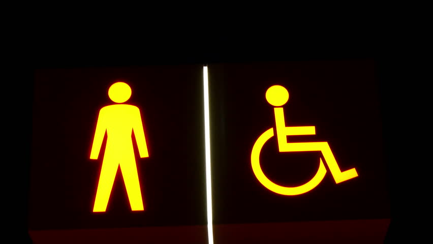 An image of a stick man and a symbol of disabled man. These can be seen on the traffic lights or subway