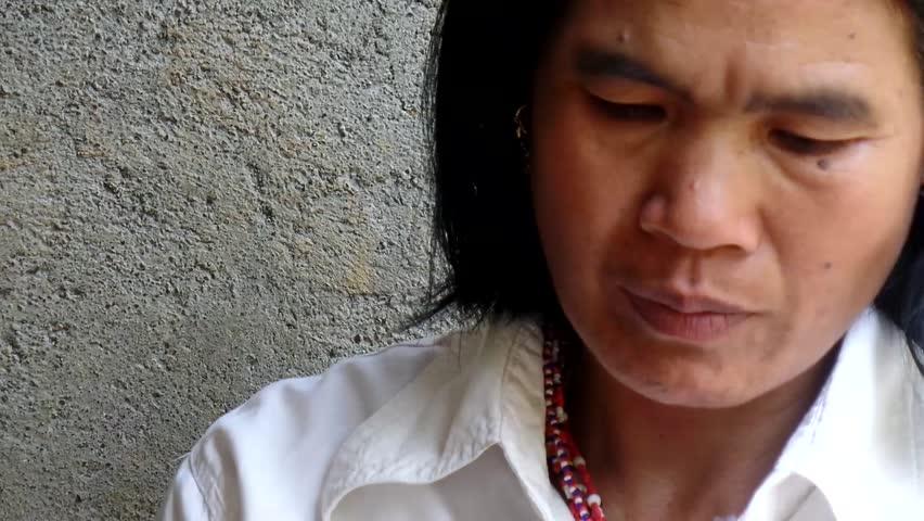 AGUINALDO, IFUGAO - APRIL 3, 2015: Mature woman chewing betel nut