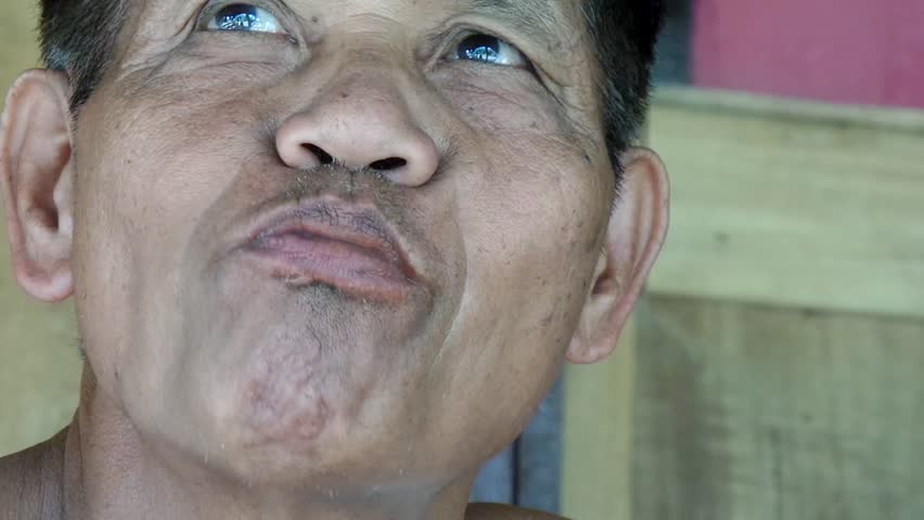 AGUINALDO, IFUGAO - APRIL 3, 2015: Mature man chewing betel nut
