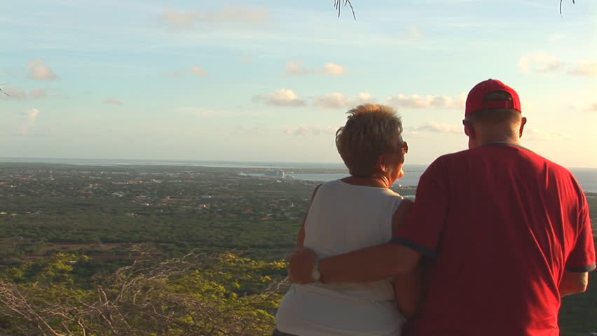 Retired couple in the tropics, kissing - HD stock footage clip