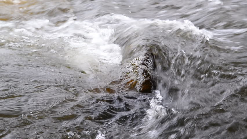 Water stream running over rocks, As the water falls from a height. - HD stock footage clip