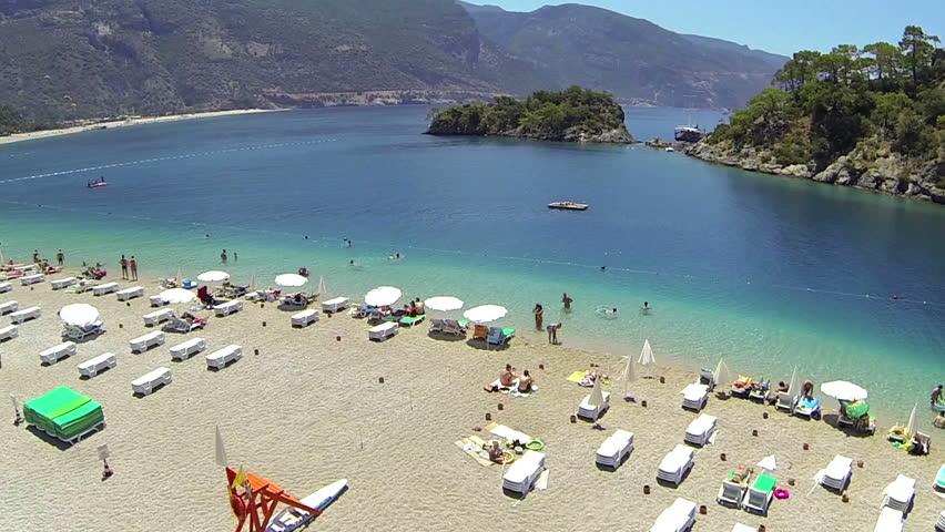 Flying over the beach at mediterranean coast of Turkey. Blue Lagoon and Oludeniz Beach at Fethiye