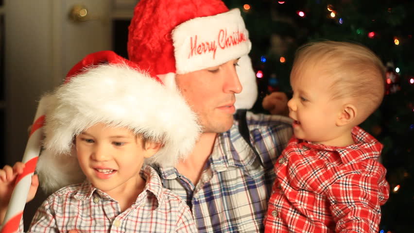 Father with two sons Christmas 1080 - HD stock video clip