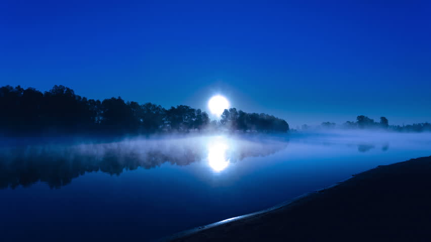 The moon above the forest and lake. Made of RAW stills from professional camera with prime wide angle lens - 4K stock footage clip