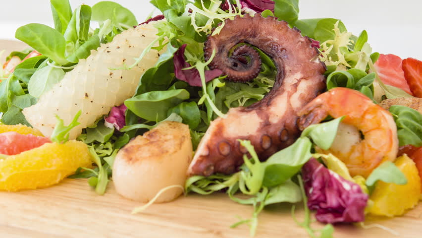 It is so tasty. Selective focus on wonderful nourishing appetizing hors-d'oeuvres or savory consisted of shrimps lettuce cheese and olives preparing by chef cook specially for you