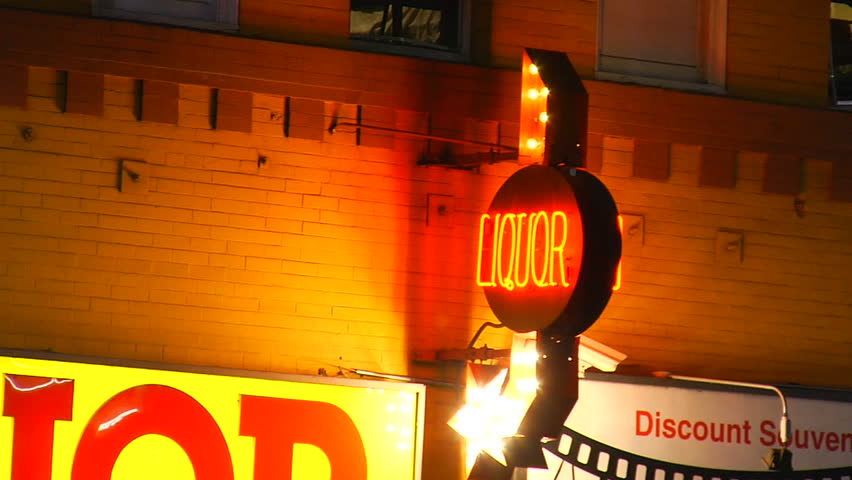 This is a flashy generic liquor store sign at night