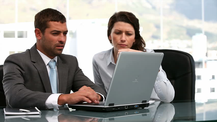 Businesswoman and a businessman working together in a office - HD stock footage clip