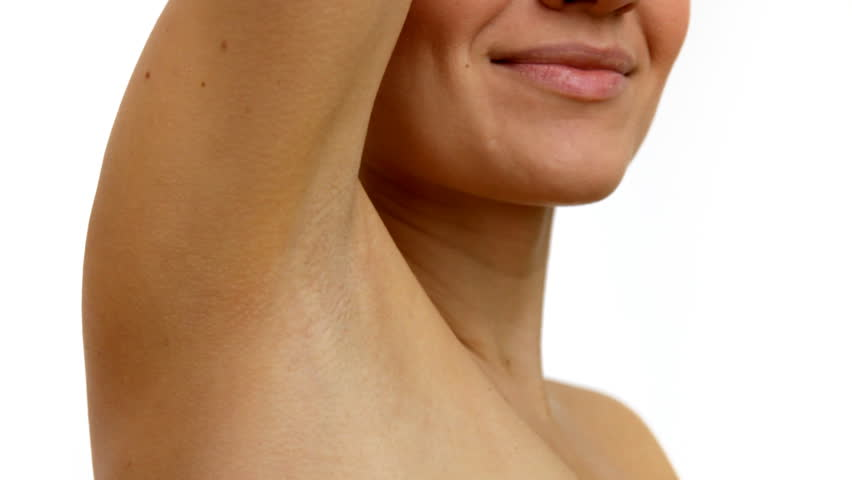Young woman stroking her clean armpit   - HD stock video clip