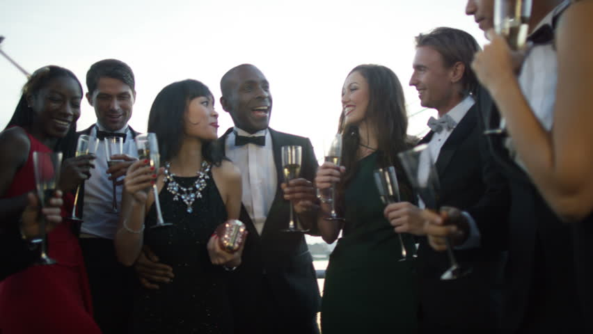 4K Happy diverse group of friends drinking champagne & having fun at boat party