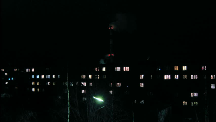Lights at block of flats windows twinkling at night, time-lapse video - HD stock video clip