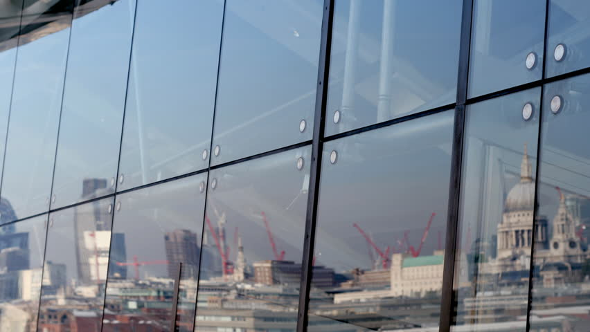 reflection of London skyline in oxo tower window - HD stock video clip