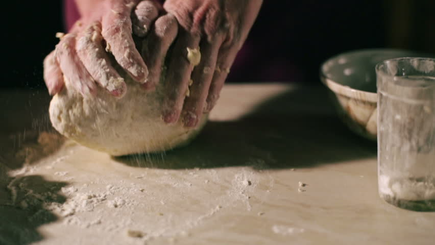 female hands kneading a dough