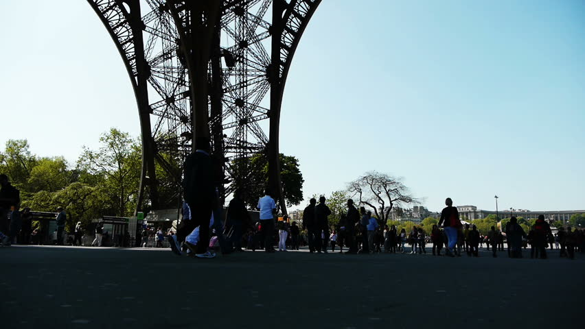 Tourists at the Eiffel Tower. Paris, France