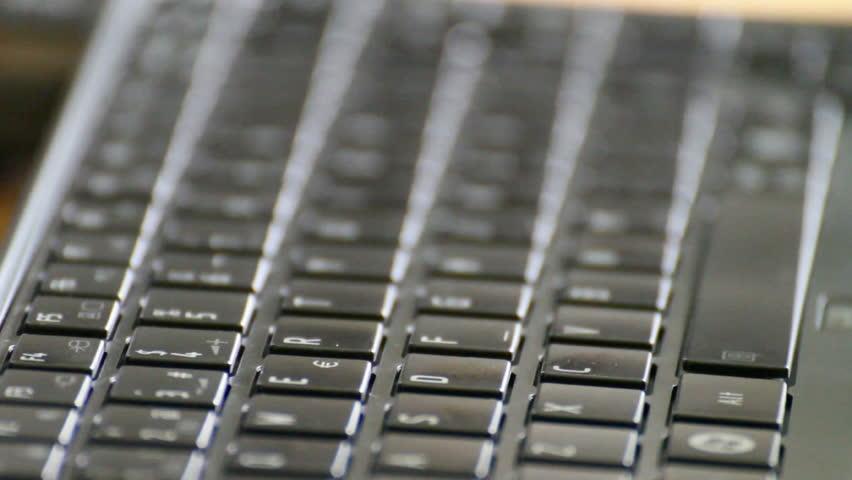 Closeup of caucasian man typing on laptop
