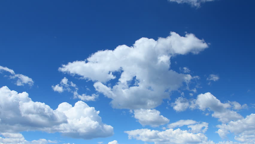 Summer Clouds fly across a royal blue sky. HD 1080p timelapse. - HD stock footage clip