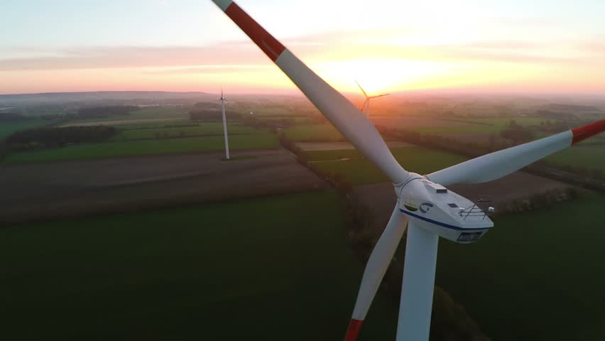 Muensterland, Germany - 20 April 2015, Wind turbines at sunset producing renewable energy - HD stock footage clip